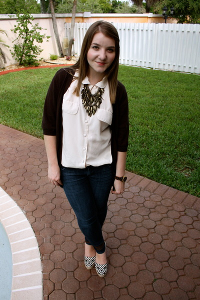 A nice blouse, cardigan and statement necklace — great with jeans at work!